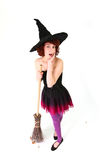 Halloween witch with a broom Stock Photo