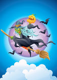 Halloween witch on broom holding pumpkin in the sky Royalty Free Stock Image