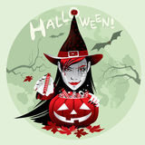 Halloween witch with candy and pumpkin. Holiday card for Halloween with the image of a witch who holds a pumpkin full of candy Royalty Free Stock Image