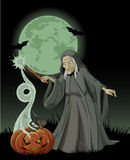 Halloween witch casts a spell Stock Photography