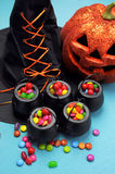 Halloween witch cauldrons full of candy - Vertical. Royalty Free Stock Images