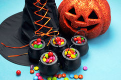 Halloween Witch Cauldrons Full Of Candy Royalty Free Stock Images