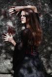 Halloween Witch in a dark forest. Beautiful young woman in witches costume . Halloween art design. Horror Background For Halloween Stock Images