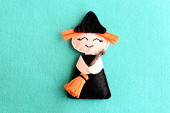 Halloween witch doll  on a blue felt background.  Halloween decor toy instructions step. Top view. Closeup Stock Photography