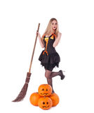 Halloween witch in  dress with pumpkin, broom Royalty Free Stock Images