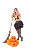 Halloween witch in  dress with pumpkin, broom Royalty Free Stock Photos