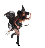 Halloween witch flying on broom. Isolated Stock Photos