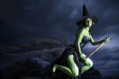 Halloween witch flying on broomstick Royalty Free Stock Image