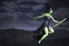 Halloween witch flying on broomstick Stock Images