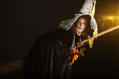 Halloween witch flying on her broom Stock Photo