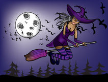 Halloween witch flying at night on the background Stock Photos