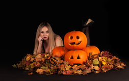Halloween witch with funny pumpkins and leaves Royalty Free Stock Photo