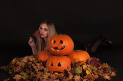 Halloween witch with funny pumpkins and leaves Royalty Free Stock Photos
