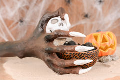 Halloween witch hand and Jack O' lantern pumpkin ornament Stock Image