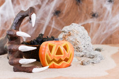 Halloween witch hand and pumpkin ornament Stock Photos