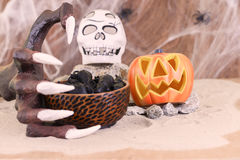 Halloween witch hand reaching for a bowl of rats Royalty Free Stock Images