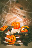 Halloween witch hands and Jack-O-Lanterns Royalty Free Stock Image