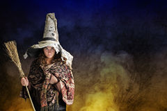 Halloween witch with hat and broom Stock Image