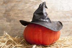 Halloween witch hat on pumpkin Stock Photo