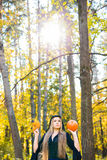 Halloween witch holding a orange pumpkin Royalty Free Stock Photography