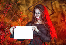 Halloween witch holding sheet of paper Royalty Free Stock Photography