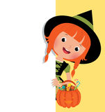Halloween witch holding a white banner Royalty Free Stock Photo