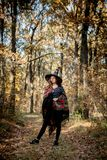 Halloween witch with a knife in the woods royalty free stock photography