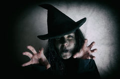 Halloween witch. Low key. Computer added dirt, scratches, grain and vignette stock photography