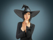 Halloween witch makes silence gesture Royalty Free Stock Photos