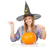 Halloween Witch with orange pumpkin Royalty Free Stock Photo