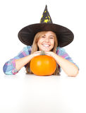Halloween Witch with orange pumpkin Stock Photo