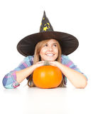 Halloween Witch with orange pumpkin Royalty Free Stock Photography