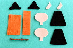 Halloween witch pattern. Felt witch doll pattern on blue background. Step. Kids crafts project. Closeup. Top view Royalty Free Stock Image