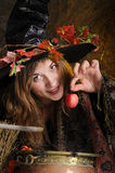 Halloween witch with poisoned apple Royalty Free Stock Photos