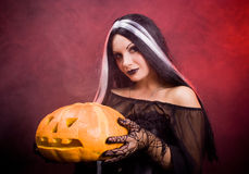 Halloween witch with a pumpkin Royalty Free Stock Photography