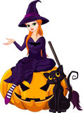 Halloween Witch on pumpkin Royalty Free Stock Photo