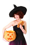 Halloween witch with a pumpkin Stock Images