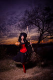 Halloween witch with a pumpkin and a broom Royalty Free Stock Images
