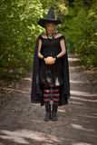 Halloween Witch with Pumpkin Stock Photography