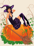 Halloween witch and pumpkin Stock Image
