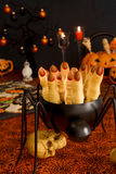 Halloween witch's fingers. Halloween sugar cookies - witch's fingers surrounded by halloween decorations stock image