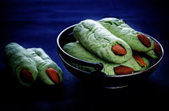 Halloween witch's fingers cookies. On a dark background. tinting. selective focus on the top biscuits Stock Images