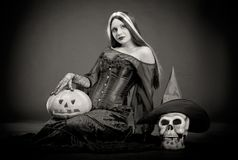 Halloween witch with a skull and pumpkin Royalty Free Stock Photography