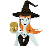 Halloween witch standing with skull Stock Photography