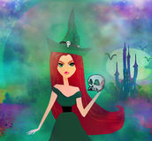 Halloween witch standing with skull Royalty Free Stock Image