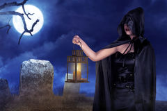 Halloween witch woman holding lantern with fog with moonlight Stock Photos