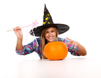 Halloween, witch woman with pumpkin, smiling Royalty Free Stock Photo