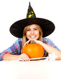 Halloween, witch woman with pumpkin, smiling Stock Photo