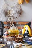 Halloween witchcraft party with herbal afternoon tea and macaron dessert in wicca and pegan concept with tarot cards. Selective f royalty free stock photography