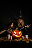 Halloween witches. With a pumpkin Royalty Free Stock Photography